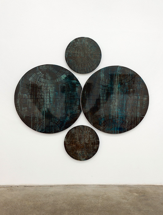 Thomas Moecker . Globe  2009  acrylic, varnish on wood  diameter 100 cm & 40 cm each